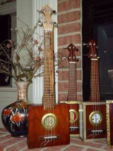 family of 4 ukuleles, 2 concert and 2 baritone